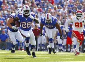 CJ Spiller gets into open space against the Chiefs in 2012 (AP Photo/Bill Wippert)