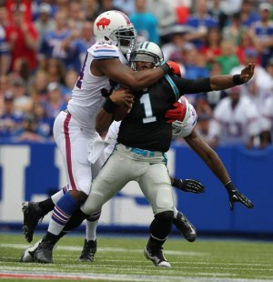 Mario Williams bring down Cam Newton for was of his 4.5 sacks (Photo Credit: The Buffalo News)