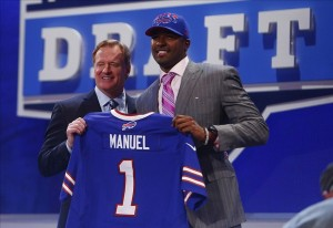 Apr 25, 2013; New York, NY, USA; NFL commissioner Roger Goodell introduces E.J. Manuel as the number sixteen overall pick to the Buffalo Bills during the 2013 NFL Draft at Radio City Music Hall. Mandatory Credit: Jerry Lai-USA TODAY Sports