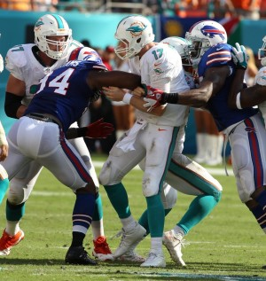 Mario Williams strip sacks Ryan Tannehill to setup Buffalo's game winning field goal. (Photo Credit: The Buffalo News)