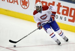 Feb 11, 2012; Toronto, ON, Canada; Montreal Canadiens defenseman PK Subban (76) retrieves the puck against the Toronto Maple Leafs at the Air Canada Centre. The Canadiens beat the Maple Leafs 5-0. Mandatory Credit: Tom Szczerbowski-USA TODAY Sports