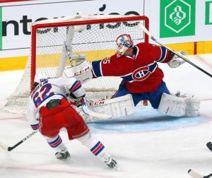 May 27, 2014; Montreal, Quebec, CAN; Montreal Canadiens goalie Dustin Tokarski (35) makes a save against New York Rangers left wing Carl Hagelin (62) during the first period in the game five of the Eastern Conference Finals of the 2014 Stanley Cup Playoffs at Bell Centre. Mandatory Credit: Jean-Yves Ahern-USA TODAY Sports