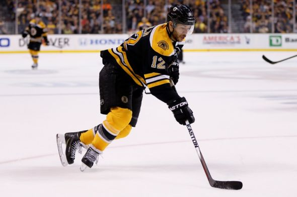 Iginla in Bruins uniform, skating