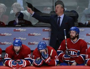 May 17, 2014; Montreal, Quebec, CAN; Montreal Canadiens head coach Michel Therrien points to the screen during the third period in game one of the Eastern Conference Finals of the 2014 Stanley Cup Playoffs against the New York Rangers at the Bell Centre. Mandatory Credit: Eric Bolte-USA TODAY Sports
