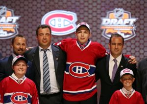 Jun 27, 2014; Philadelphia, PA, USA; Nikita Scherbak poses for a photo with team officials after being selected as the number twenty-six overall pick to the Montreal Canadiens in the first round of the 2014 NHL Draft at Wells Fargo Center. Mandatory Credit: Bill Streicher-USA TODAY Sports