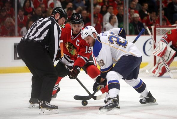 Ott in Blues uniform facing off against Toews