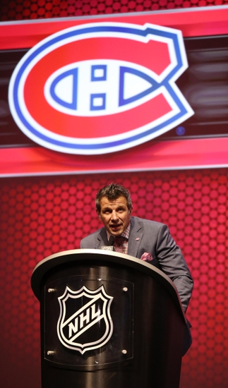 Jun 27, 2014; Philadelphia, PA, USA; Montreal Canadiens general manager Marc Bergevin announces Nikita Scherbak (not pictured) as the number twenty-six overall pick to the Montreal Canadiens in the first round of the 2014 NHL Draft at Wells Fargo Center. Mandatory Credit: Bill Streicher-USA TODAY Sports