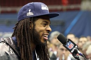 Jan 28, 2014; Newark, NJ, USA; Seattle Seahawks cornerback Richard Sherman (25) is interviewed during Media Day for Super Bowl XLIII at Prudential Center. Mandatory Credit: Brad Penner-USA TODAY Sports