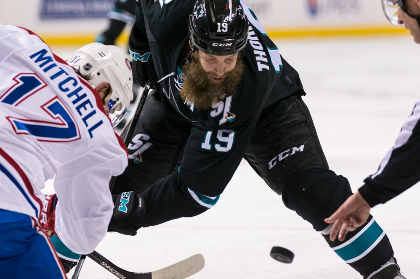 9718380-torrey-mitchell-joe-thornton-nhl-montreal-canadiens-san-jose-sharks