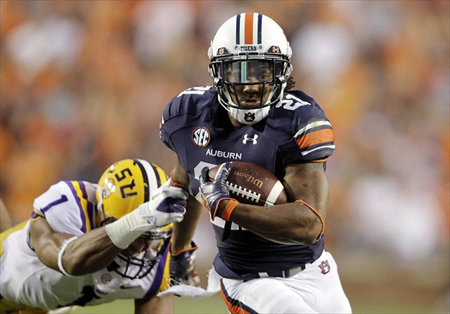 Sep 22, 2012; Auburn, AL, USA; LSU Tigers safety Eric Reid (1) misses the tackle on Auburn Tigers running back Tre Mason (21) during the first quarter at Jordan-Hare Stadium. Mandatory Credit: John Reed-USA TODAY Sports