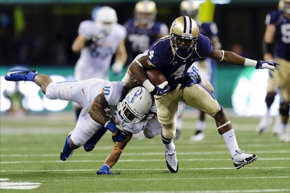 Aug 31, 2013; Seattle, WA, USA; Washington Huskies wide receiver Jaydon Mickens (4) breaks a tackle by Boise State Broncos safety Jeremy Ioane (10) during the 2nd half at Husky Stadium. Washington defeated Boise State 38-6. Mandatory Credit: Steven Bisig-USA TODAY Sports