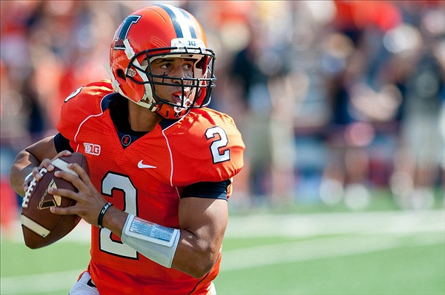 Sep 7, 2013; Champaign, IL, USA; Illinois Fighting Illini quarterback Nathan Scheelhaase (2) looks for an open receiver during the first quarter against the Cincinnati Bearcats at Memorial Stadium. Mandatory Credit: Bradley Leeb-USA TODAY Sports