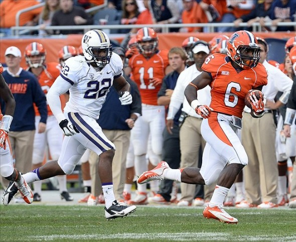 Sep 14, 2013; Chicago, IL, USA; Illinois Fighting Illini running back Josh Ferguson (6) rushes the ball against Washington Huskies defensive end Josh Shirley (22) during the first half at Soldier Field. Mandatory Credit: Mike DiNovo-USA TODAY Sports