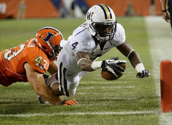 Sep 14, 2013; Chicago, IL, USA; Washington Huskies wide receiver Jaydon Mickens (4) scores a touchdown against Illinois Fighting Illini linebacker Mason Monheim (43) during the second half at Soldier Field. Washington defeats Illinois 34-24. Mandatory Credit: Mike DiNovo-USA TODAY Sports