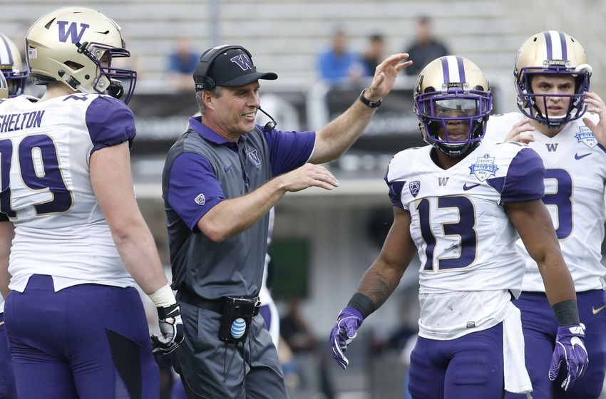 Dec 26, 2015; Dallas, TX, USA; Washington Huskies head coach Chris Peterson reacts after a play in the game against the Southern Miss Golden Eagles at Cotton Bowl Stadium. Mandatory Credit: Tim Heitman-USA TODAY Sports