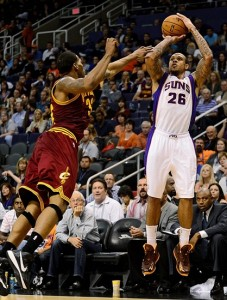 Nov. 09, 2012; Phoenix, AZ, USA; Phoenix Suns guard Shannon Brown (26) puts up a shot against the Cleveland Cavaliers forward Alonzo Gee (33) during the second half at US Airways Center. The Suns defeated the Cavaliers 107-105. Mandatory Credit: Jennifer Stewart-US PRESSWIRE