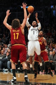 November 13, 2012; Brooklyn, NY, USA; Brooklyn Nets guard C.J. Watson (1) shoots the ball while defended by Cleveland Cavaliers center Anderson Varejao (17) during the third quarter of an NBA game at the Barclays Center. Mandatory Credit: Brad Penner-US PRESSWIRE