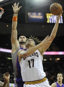 Nov 27, 2012; Cleveland, OH, USA; Cleveland Cavaliers center Anderson Varejao (17) shoots against Phoenix Suns center Marcin Gortat (4) in the third quarter at Quicken Loans Arena. Mandatory Credit: David Richard-US PRESSWIRE