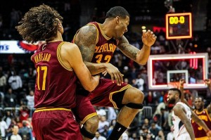 Nov 30, 2012; Atlanta, GA, USA; Cleveland Cavaliers center Anderson Varejao (17) celebrates with small forward Alonzo Gee (33) after beating the Atlanta Hawks at Philips Arena. The Cavaliers won 113-111. Mandatory Credit: Daniel Shirey-US PRESSWIRE