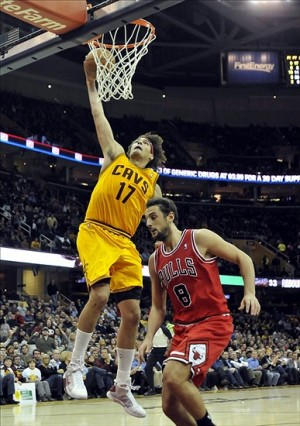 Dec 5, 2012; Cleveland, OH, USA; Cleveland Cavaliers center Anderson Varejao (17) slam dunks beside Chicago Bulls shooting guard Marco Belinelli (8) in the fourth quarter at Quicken Loans Arena. Mandatory Credit: David Richard-USA TODAY Sports