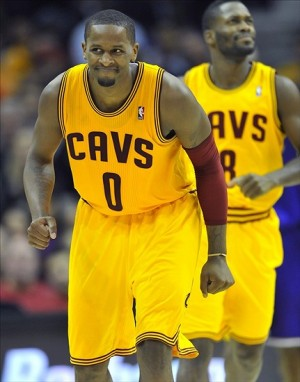 Dec 11, 2012; Cleveland, OH, USA; Cleveland Cavaliers small forward C.J. Miles (0) celebrates a three-point basket in the fourth quarter against the Los Angeles Lakers at Quicken Loans Arena. Mandatory Credit: David Richard-USA TODAY Sports