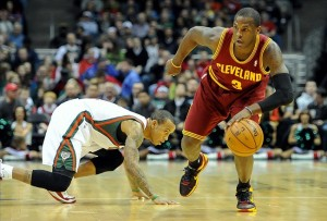 Dec 22, 2012; Milwaukee, WI, USA; Cleveland Cavaliers guard Dion Waiters (3) gets away from Milwaukee Bucks guard Monta Ellis (11) at the Bradley Center. Mandatory Credit: Benny Sieu-USA TODAY Sports