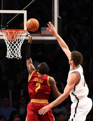 Dec. 29, 2012; Brooklyn, NY, USA; Cleveland Cavaliers point guard Kyrie Irving (2) goes up for a shot as Brooklyn Nets center Brook Lopez (11) defends during the second half at Barclays Center. Nets won 103-100. Mandatory Credit: Debby Wong-USA TODAY Sports