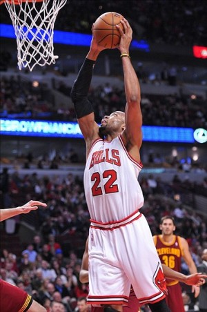 Jan 7, 2013; Rosemont, IL, USA; Chicago Bulls power forward Taj Gibson (22) goes to the basket against the Cleveland Cavaliers during the second half at the United Center. The Bulls beat the Cavaliers 118-92. Mandatory Credit: Rob Grabowski-USA TODAY Sports