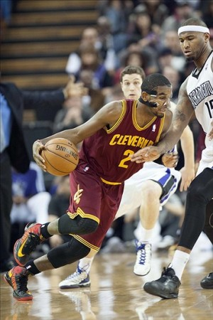 Jan 14, 2013; Sacramento, CA, USA; Cleveland Cavaliers point guard Kyrie Irving (2) dribbles the ball around Sacramento Kings center DeMarcus Cousins (15) during the third quarter at Sleep Train Arena. The Sacramento Kings defeated the Cleveland Cavaliers 124-118. Mandatory Credit: Ed Szczepanski-USA TODAY Sports