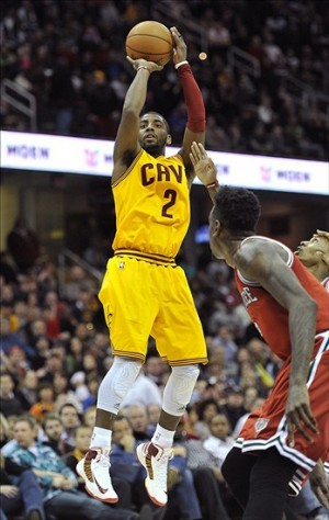 Jan 25, 2013; Cleveland, OH, USA; Cleveland Cavaliers point guard Kyrie Irving (2) attempts a shot in the fourth quarter against the Milwaukee Bucks at Quicken Loans Arena. Mandatory Credit: David Richard-USA TODAY Sports