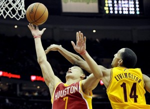 Jan 5, 2013; Cleveland, OH, USA; Cleveland Cavaliers point guard Shaun Livingston (14) fouls Houston Rockets point guard Jeremy Lin (7) in the fourth quarter at Quicken Loans Arena. Mandatory Credit: David Richard-USA TODAY Sports