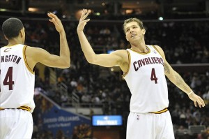 Feb 6, 2013; Cleveland, OH, USA; Cleveland Cavaliers small forward Luke Walton (4) and point guard Shaun Livingston (14) celebrate in the fourth quarter against the Charlotte Bobcats at Quicken Loans Arena. Mandatory Credit: David Richard-USA TODAY Sports