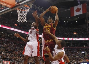Mar 10, 2013; Toronto, Ontario, CAN; Cleveland Cavaliers forward Tristan Thompson (13) tries to make a basket as Toronto Raptors guard Terrence Ross (31) and guard Kyle Lowry (3) defend during the first half at the Air Canada Centre. Mandatory Credit: John E. Sokolowski-USA TODAY Sports