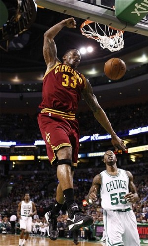 Apr 5, 2013; Boston, MA, USA; Cleveland Cavaliers small forward Alonzo Gee (33) dunks the ball against the Boston Celtics during the first half at TD Garden. Mandatory Credit: Mark L. Baer-USA TODAY Sports