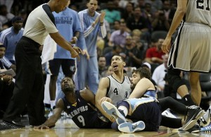 May 19, 2013; San Antonio, TX, USA; Memphis Grizzlies center Marc Gasol (33) and Tony Allen (9) and San Antonio Spurs shooting guard Danny Green (4) battle for a loose ball during the third quarter in game one of the Western Conference finals of the 2013 NBA Playoffs at AT