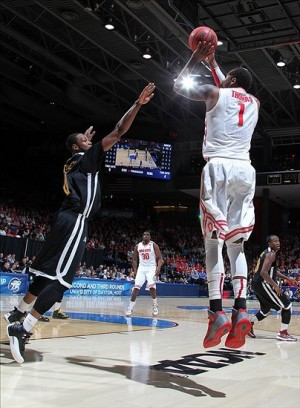 Mar 22, 2013; Dayton, OH, USA; Ohio State Buckeyes forward DeShaun Thomas (1) takes a shot against Iona Gaels forward Taaj Ridley (0) during the second round of the 2013 NCAA tournament at University of Dayton Arena. Mandatory Credit: Brian Spurlock-USA TODAY Sports