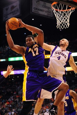 Apr. 7, 2012; Phoenix, AZ, USA; Phoenix Suns center Marcin Gortat (4) and Lakers center Andrew Bynum (17) battle for the rebound during the game against the Los Angeles Lakers at the US Airways Center. The Suns defeated the Lakers 125-105. Mandatory Credit: Mark J. Rebilas-USA TODAY Sports