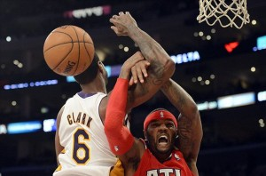 Mar 3, 2013; Los Angeles, CA, USA; Atlanta Hawks small forward Josh Smith (5) and Los Angeles Lakers small forward Earl Clark (6) get tangled up during the game at the Staples Center. Mandatory Credit: Richard Mackson-USA TODAY Sports