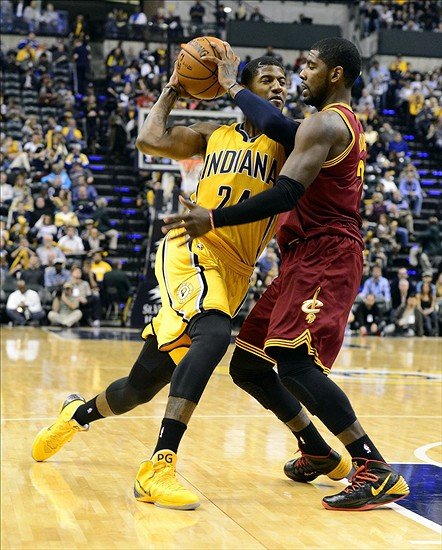 Nov 2, 2013; Indianapolis, IN, USA; Indiana Pacers small forward Paul George (24) makes a drive against Cleveland Cavaliers point guard Kyrie Irving (2) during the second half of the game. Indiana won 89-74 at Bankers Life Fieldhouse. Mandatory Credit: Marc Lebryk-USA TODAY Sports