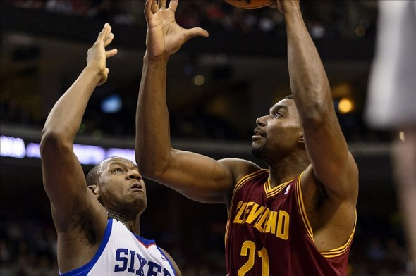 Nov 8, 2013; Philadelphia, PA, USA; Cleveland Cavaliers center Andrew Bynum (21) shoots under pressure from Philadelphia 76ers center Lavoy Allen (50) during the third quarter at Wells Fargo Center. The Sixers defeated the Cavaliers 94-79. Mandatory Credit: Howard Smith-USA TODAY Sports