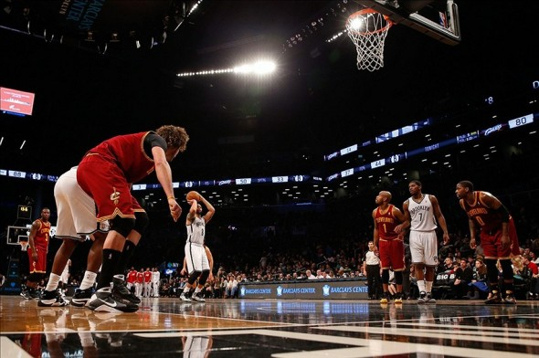 Jan 4, 2014; Brooklyn, NY, USA; Brooklyn Nets point guard Deron Williams (8) shoots a free throw during the fourth quarter against the Cleveland Cavaliers at Barclays Center. Brooklyn Nets won 89-82. Mandatory Credit: Anthony Gruppuso-USA TODAY Sports