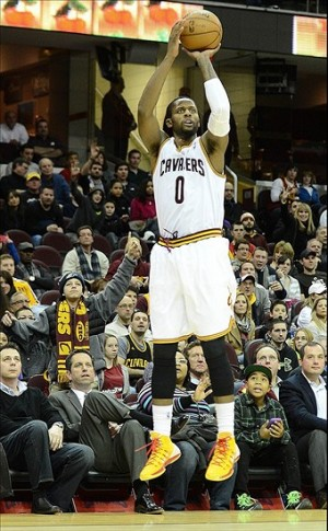Jan 7, 2014; Cleveland, OH, USA; Cleveland Cavaliers shooting guard C.J. Miles (0) shoots the ball during the game against the Philadelphia 76ers at Quicken Loans Arena. Mandatory Credit: Eric P. Mull-USA TODAY Sports
