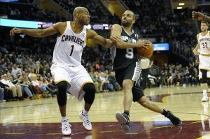 Mar 4, 2014; Cleveland, OH, USA; San Antonio Spurs point guard Tony Parker (9) drives against Cleveland Cavaliers point guard Jarrett Jack (1) in the third quarter at Quicken Loans Arena. Mandatory Credit: David Richard-USA TODAY Sports