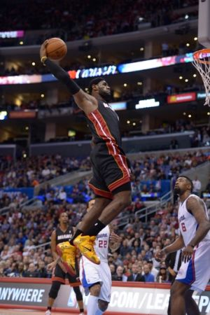 Feb 5, 2014; Los Angeles, CA, USA; Miami Heat forward LeBron James (6) dunks the ball against the Los Angeles Clippers at Staples Center. Mandatory Credit: Kirby Lee-USA TODAY Sports
