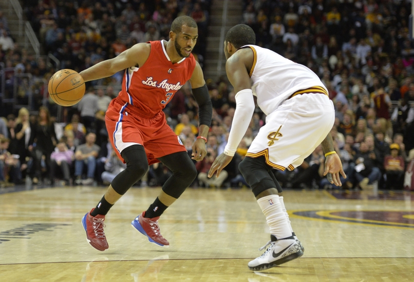 Feb 5, 2015; Cleveland, OH, USA; Los Angeles Clippers guard Chris Paul (3) drives against Cleveland Cavaliers guard Kyrie Irving (2) in the second quarter at Quicken Loans Arena. Mandatory Credit: David Richard-USA TODAY Sports