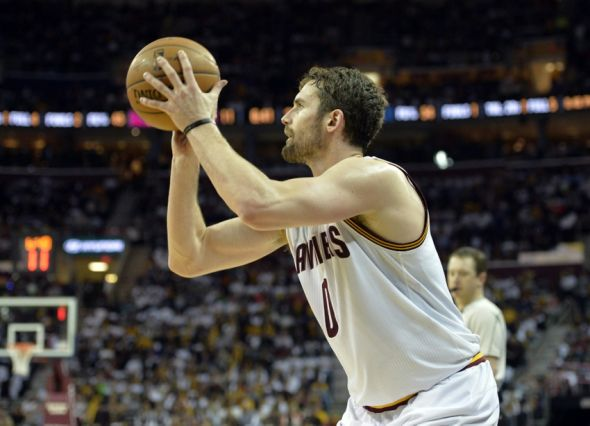 Apr 15, 2015; Cleveland, OH, USA; Cleveland Cavaliers forward Kevin Love (0) shoots a three-point basket in the second quarter against the Washington Wizards at Quicken Loans Arena. Mandatory Credit: David Richard-USA TODAY Sports