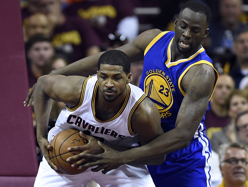 Jun 16, 2015; Cleveland, OH, USA; Cleveland Cavaliers center Tristan Thompson (13) fights for a rebound against Golden State Warriors forward Draymond Green (23) during the second quarter in game six of the NBA Finals at Quicken Loans Arena. Mandatory Credit: Bob Donnan-USA TODAY Sports