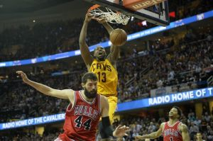 May 12, 2015; Cleveland, OH, USA; Cleveland Cavaliers center Tristan Thompson (13) dunks again Chicago Bulls forward Nikola Mirotic (44) and guard Derrick Rose (1) in the fourth quarter in game five of the second round of the NBA Playoffs at Quicken Loans Arena. Mandatory Credit: David Richard-USA TODAY Sports