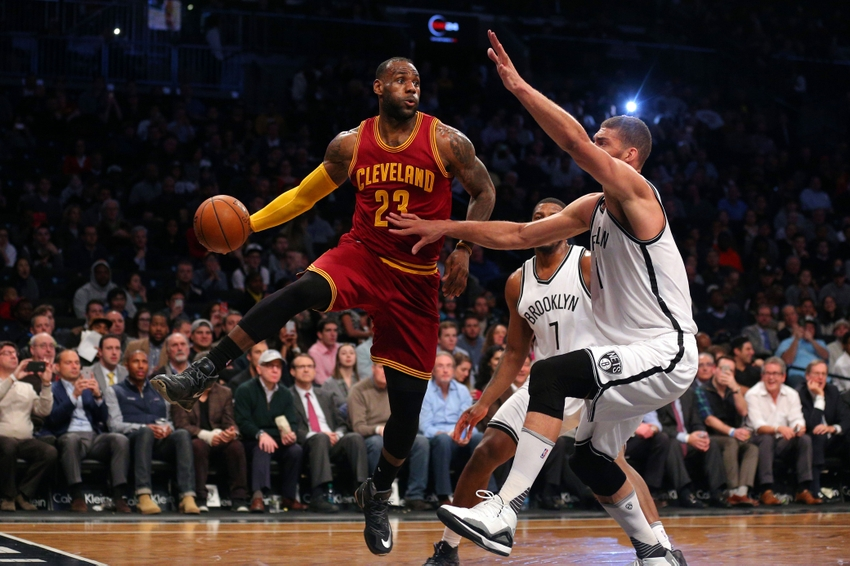 Jan 20, 2016; Brooklyn, NY, USA; Cleveland Cavaliers small forward LeBron James (23) passes around Brooklyn Nets center Brook Lopez (11) during the first quarter at Barclays Center. Mandatory Credit: Brad Penner-USA TODAY Sports