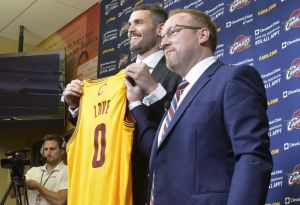 Aug 26, 2014; Independence, OH, USA; Cleveland Cavaliers player Kevin Love (left) and general manager David Griffin pose for photographers at Cleveland Clinic Courts. Mandatory Credit: David Richard-USA TODAY Sports